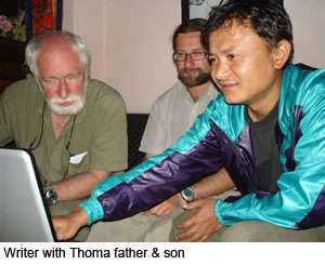 Writer with Thoma father and son